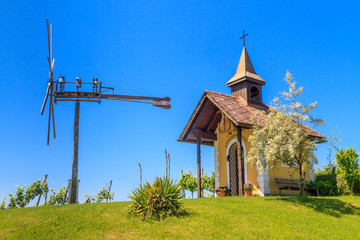 Styrian Tuscany Vineyard with small chapel and windmill, Styria,