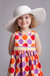 Beautiful little girl in a wide-brimmed hat