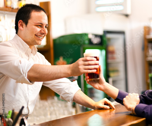 Bartender serving a beer