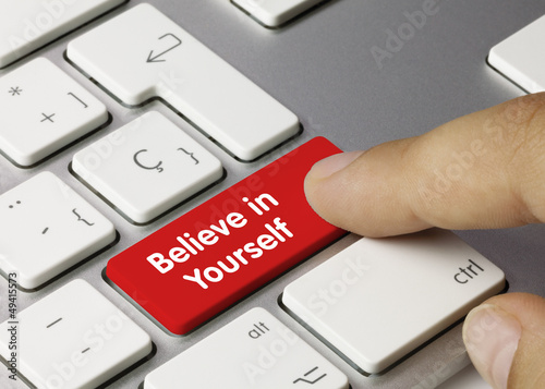 Believe in Yourself keyboard key. Finger