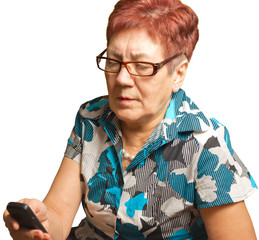 An elderly woman is calling on a cell phone, isolated.