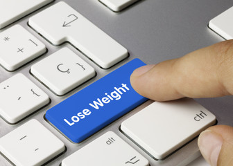 Lose Weight keyboard key. Finger