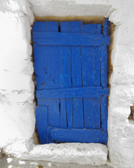 blue door of a typical Mediterranean island house