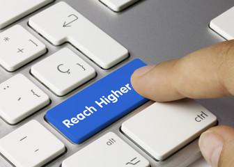 Reach Higher keyboard key. Finger