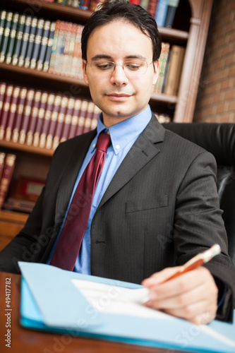 Man writing on a document
