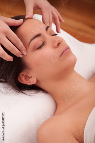 Massage treatment of the head