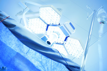 light of medical lamps in the operating room