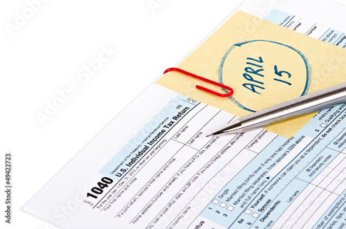 Tax return form with attached due date note reminder