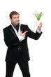Smiling young businessman pointing his finger at the flower. Iso