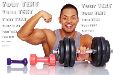 Attractive man posing in a studio with dumbbells