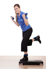 Young woman during step workout