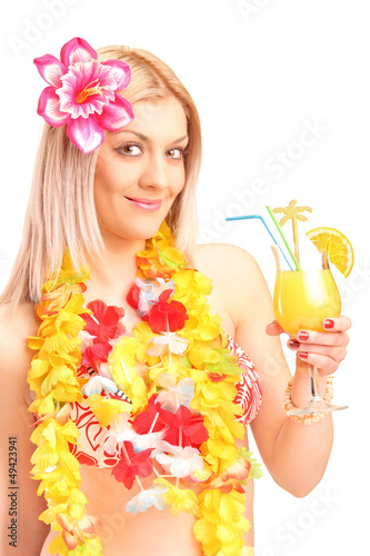 A smiling blond woman dressed in traditional costume drinking co