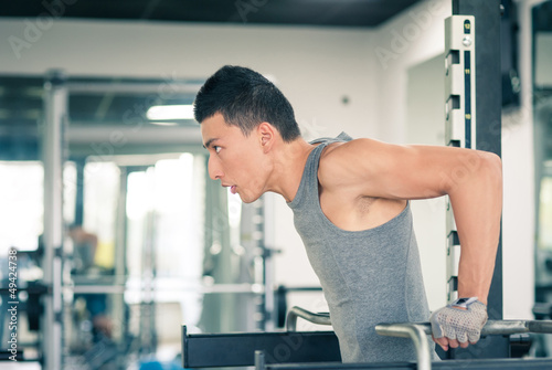 Young asian man training in the gym.