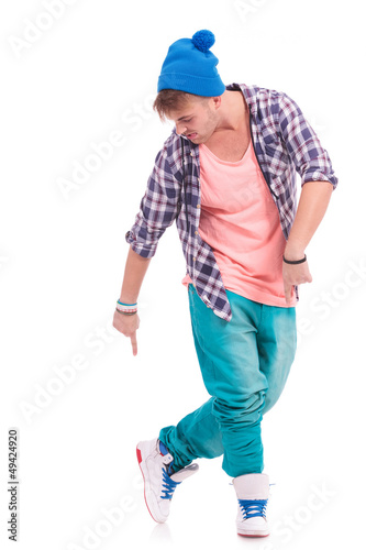 dancer pointing & looking at his shoes
