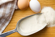 flour in metal scoop