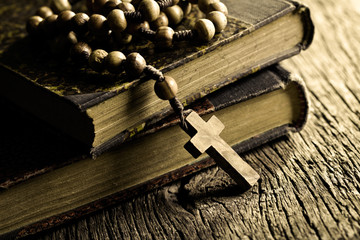 rosary beads on old books