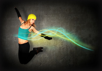Woman jumping/dancing with glowing lines around her