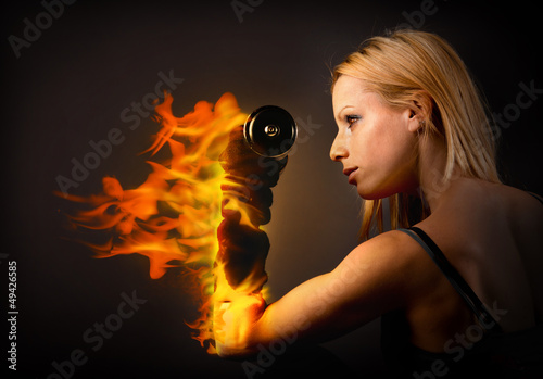 Woman lifting a weight on fire