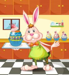 A bunny baking an egg-designed cupcakes