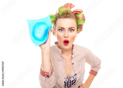 surprised housewife holding rag