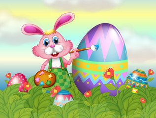 A bunny painting the egg in the garden