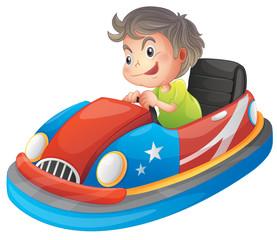 A young boy riding a bumper car
