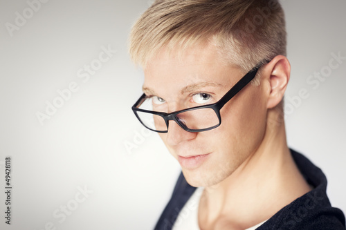 Close up of attractive man wearing glasses.