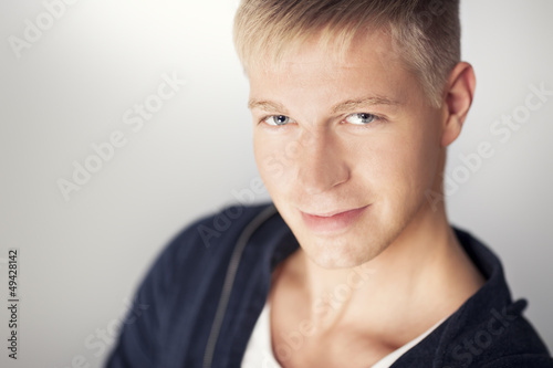 Close up of attractive young man looking seductive.