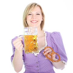 Laughing girl with beer and a pretzel