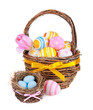 Colorful  Easter eggs in a basket and spring flowers