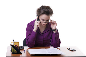 Businesswoman looking throu her glasses at documents isolated on