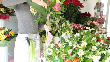 Florist Arranging Bunch Of Flowers In Floristry Shop