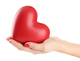 Red heart in woman hand, isolated on white