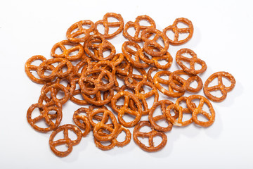 salted pretzels on white background