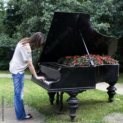 woman playing on an old piano,