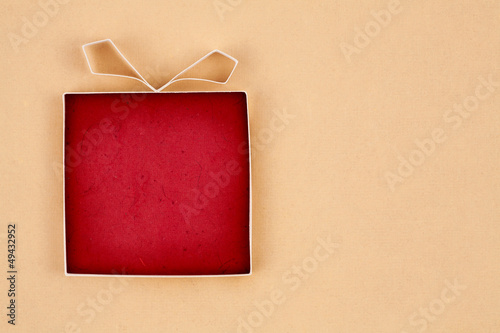 Hand made empty gift box, textured paper as background.