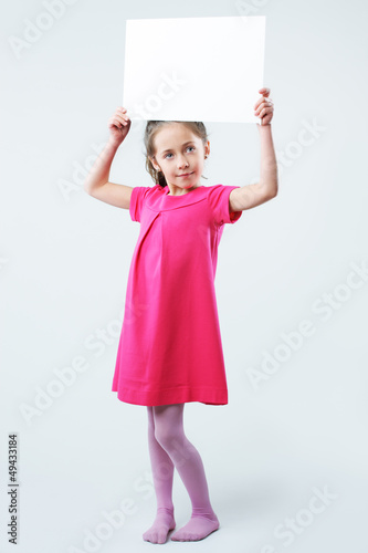 Little girl holding blank signs