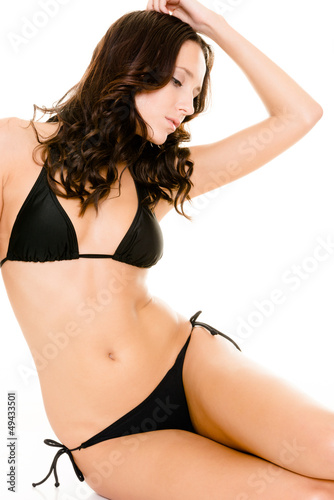 Woman with black bikini sitting in the studio