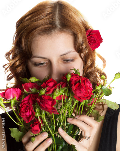 girl smelling roses on a white background isolated