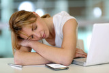 Office worker falling asleep during working hours