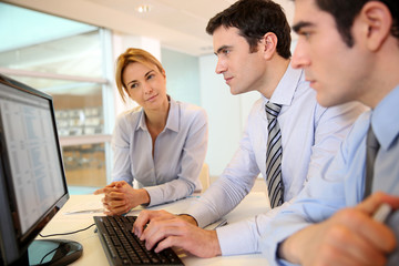 Business team working in front of desktop