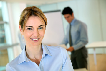 Cheerful businesswoman attending seminar