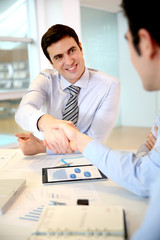 Businessman shaking hand to business partner