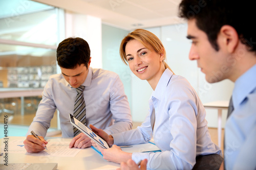Smiling businesswoman attending meeting
