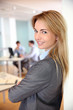 Beautiful blond businesswoman in meeting room
