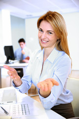 Cheerful businesswoman giving good arguments