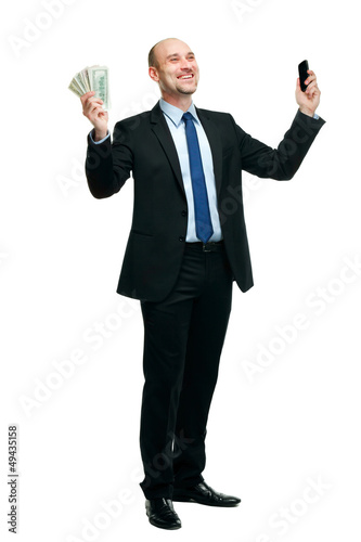 Happy man holding money and phone, isolated on white background