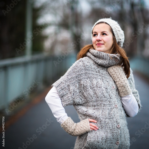 young woman dressed in a warm woolen cardigan