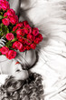 Woman with big bouquet of red roses