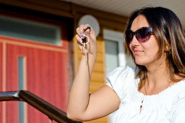 Woman holding the key to a property